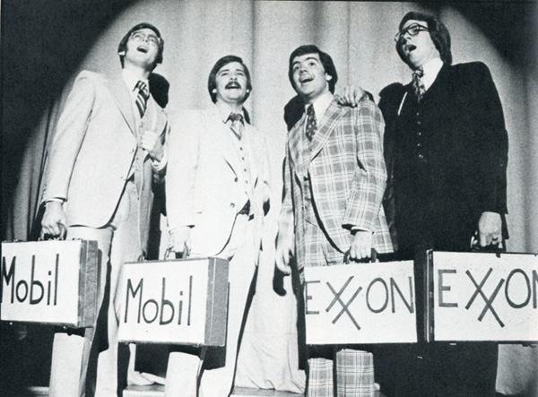 "Performers holding ""Mobil"" and ""Exxon"" briefcases, 1978"